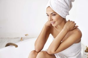 Shot of a beautiful young woman relaxing in the bathroom in a towel